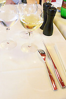 Silverware knife and fork on linen table cloth and napkin and wine glasses, the restaurant Blanc Le Bistrot in Toulon, very design art-deco Toulon Var Cote d'Azur France