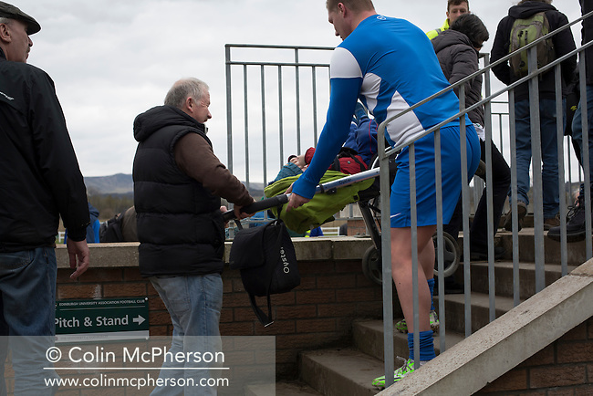 Visiting striker Garry O'Connor helping a man carrying a child in a pram up a stairway before Edinburgh University took on Selkirk in a Scottish Lowland League match at Peffermill, Edinburgh in a game the hosts won 3-2. The match was one of six attended by members of GroundhopUK over the weekend to accommodate groundhoppers, fans who attempt to visit as many football venues as possible. Around 100 fans in two coaches from England participated in the 2016 Lowland League Groundhop and they were joined by other individuals from across the UK which helped boost crowds at the six featured matches.