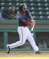 Outfielder Wilfred Pichardo (7) of the Greenville Drive hits in the first game of a doubleheader against the Rome Braves on August 15, 2011, at Fluor Field at the West End in Greenville, South Carolina. (Tom Priddy/Four Seam Images)