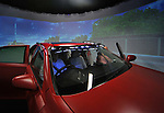 """July 21st, 2011, Susonosi, Japan - A visiting reporter sits behind the wheel of a driving simulator at Toyotas Higashi-Fuji Technical Center on the foot of Mt. Fuji, some 92km (about 57 miles) southwest of Tokyo, on Thursday, July 21, 2011. Toyota showed to reporters technologies aimed at increasing safety for pedestrians and elderly drivers, as part of its initiatives to eliminate traffic casualties. The technologies include a Pre-Collision System with collision-avoidance assist, glare-preventing adaptive driving beams and a pop-up hood for lessening pedestrian injury. In the PCS, Toyota uses cameras and a super sensitive radar called """"millimeter-wave,"""" both installed in the front of the vehicle, to detect possible crashes such as a pedestrian crossing the road. Then the vehicle calculates how braking and steering must be applied to avoid a crash. (Photo by Natsuki Sakai/AFLO) [3615] -mis-"""