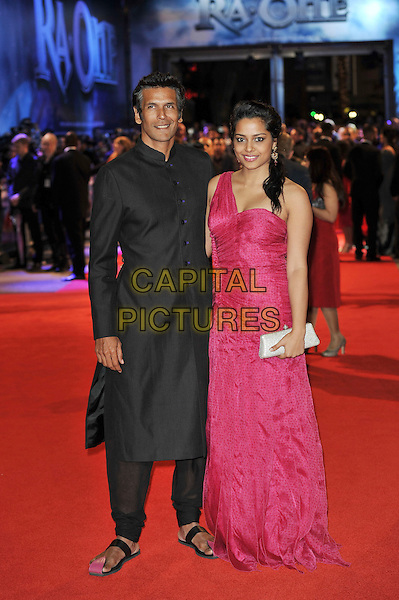 guest & Shahana Goswami.'RA. One' UK premiere at Cineworld, O2 Arena, Greenwich, London, England..25th October 2011.full length pink dress black jacket long one shoulder clutch bag silver .CAP/MAR.© Martin Harris/Capital Pictures.