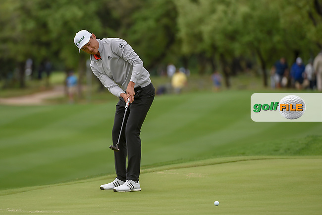 HaoTong Li (CHN) watches his putt on 12 during day 4 of the Valero Texas Open, at the TPC San Antonio Oaks Course, San Antonio, Texas, USA. 4/7/2019.<br /> Picture: Golffile | Ken Murray<br /> <br /> <br /> All photo usage must carry mandatory copyright credit (© Golffile | Ken Murray)