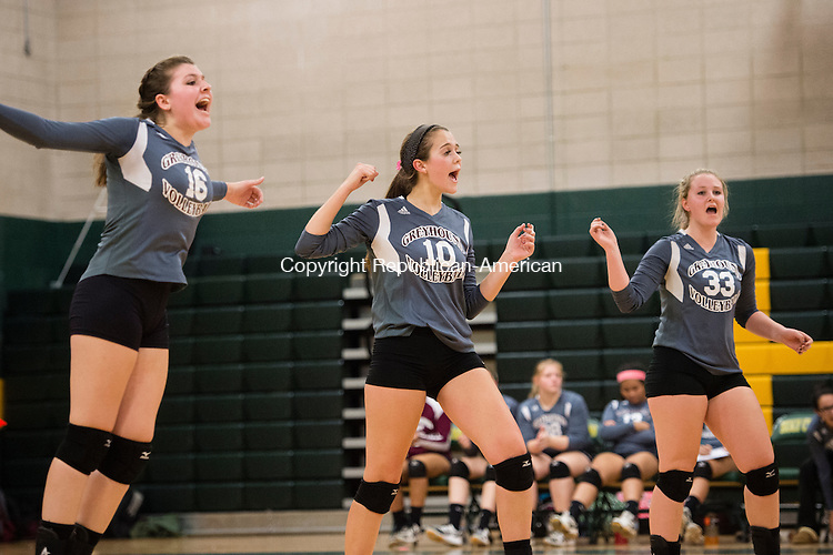 WATERBURY, CT - 8 October 2015-100815EC08-- The Greyhounds celebrate the final point that sealed a win over Holy Cross, 3-0, Thursday night. From L to R: (16) Nicole Healy, (10) Olivia Rotatori and (33) Emma Healy. Erin Covey Republican-American.