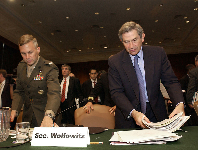6/25/04.TRANSITION TO SOVEREIGNTY IN IRAQ--Paul D. Wolfowitz. deputy secretary of Defense, right, and an aide gather papers after the Senate Armed Services hearing on the transition to sovereignty in Iraq, focusing on U.S. policy, ongoing military operations and the status of U.S. armed forces..CONGRESSIONAL QUARTERLY PHOTO BY SCOTT J. FERRELL