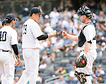 (L-R) Masahiro Tanaka, Brian McCann (Yankees), JULY 9, 2015 - MLB : New York Yankees starting pitcher Masahiro Tanaka (C) is pulled during the eighth inning of a baseball game against the Oakland Athletics at Yankee Stadium in New York, United States. (Photo by AFLO)