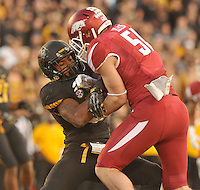 NWA Media/Michael Woods --11/28/2014-- w @NWAMICHAELW...University of Arkansas linebacker Brooke Ellis puts the hit on Missouri running back Marcus Murphy as he tries to run the ball in the 3rd quarter of Fridays game against Missouri at Faurot Field in Columbia Missouri.