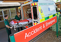 Paramedic ambulance crew lifting a child on a stretcher from the back of the ambulance into the accident and emergency department of the hospital...© SHOUT. THIS PICTURE MUST ONLY BE USED TO ILLUSTRATE THE EMERGENCY SERVICES IN A POSITIVE MANNER. CONTACT JOHN CALLAN. Exact date unknown.john@shoutpictures.com.www.shoutpictures.com..