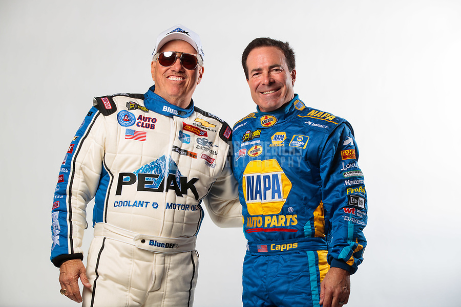 Feb 6, 2019; Pomona, CA, USA; NHRA funny car drivers John Force (left) and Ron Capps pose for a portrait during NHRA Media Day at the NHRA Museum. Mandatory Credit: Mark J. Rebilas-USA TODAY Sports