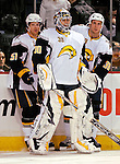 31 March 2007: Buffalo Sabres goaltender Ryan Miller (30) is flanked by defensemen Brian Campbell (51) and Nathan Paetsch (38) during pre-game warms ups prior to a game against the Montreal Canadiens at the Bell Centre in Montreal, Canada...Mandatory Photo Credit: Ed Wolfstein Photo *** Editorial Sales through Icon Sports Media *** www.iconsportsmedia.com