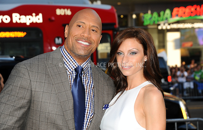 ACEPIXS.COM<br /> <br /> July 23 2014, LA<br /> <br /> Dwayne Johnson and Lauren Hashian arriving at the Premiere Of Paramount Pictures' 'Hercules' at the TCL Chinese Theatre on July 23, 2014 in Hollywood, California. <br /> <br /> <br /> By Line: Peter West/ACE Pictures<br /> <br /> ACE Pictures, Inc.<br /> www.acepixs.com<br /> Email: info@acepixs.com<br /> Tel: 646 769 0430