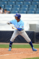 Daytona Cubs shortstop Marco Hernandez (11) looks to lay down a bunt during a game against the Tampa Yankees  on April 13, 2014 at George M. Steinbrenner Field in Tampa, Florida.  Tampa defeated Daytona 7-3.  (Mike Janes/Four Seam Images)