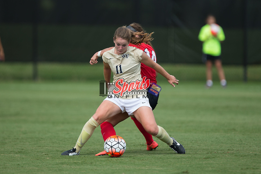 Maddie Huster (11) of the Wake Forest Demon Deacons keeps the ball away from Sydney Shultis (14) of the Georgia Bulldogs during first half action at Spry Soccer Stadium on August 23, 2015 in Winston-Salem, North Carolina.  The Deacons defeated the Bulldogs 4-0.  (Brian Westerholt/Sports On Film)