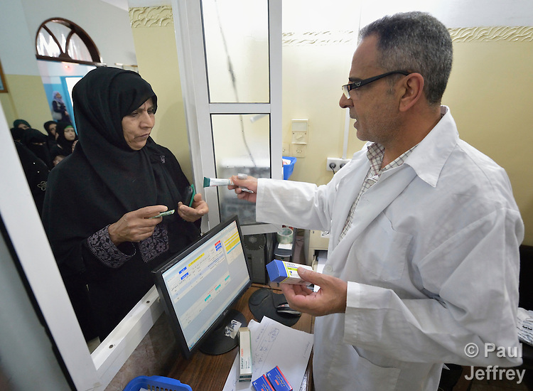Pharmacist Alaa Eldain al Ghazali provides medication to a woman in a clinic in Darraj, a neighborhood of Gaza City that was hard hit by the Israeli military during the 2014 war. The clinic is run by the Department of Service for Palestinian Refugees of the Near East Council of Churches, a member of the ACT Alliance, and funded in part by the Pontifical Mission for Palestine.