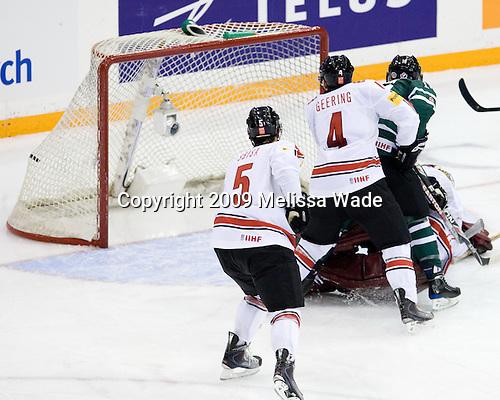Luca Sbisa (Switzerland - 5), Patrick Geering (Switzerland - 4), Stefan Della-Rovere (Canada - 19) - Team Canada defeated Team Switzerland 6-0 on Monday, December 28, 2009, at Credit Union Centre in Saskatoon, Saskatchewan, during the 2010 World Juniors tournament.