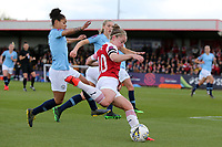 Kim Little of Arsenal Women gets in a cross despite pressure from Demi Stokes of Manchester City Women during Arsenal Women vs Manchester City Women, FA Women's Super League Football at Meadow Park on 11th May 2019