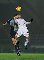 Luke O'Nien of Wycombe Wanderers & Curtis Thompson of Notts County go up for the ball during the Sky Bet League 2 match between Wycombe Wanderers and Notts County at Adams Park, High Wycombe, England on 15 December 2015. Photo by Andy Rowland.