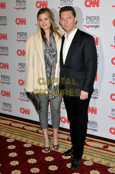 HOLLY VALANCE & NICK CANDY .attending the launch of 'Piers Morgan Tonight' on CNN at Mandarin Oriental Hyde Park, London, England, UK, December 7th, 2010..full length beige cream fur coat suit white shirt couple grey gray cropped trousers print top peep toe shoes clutch bag jacket .CAP/PL.©Phil Loftus/Capital Pictures.