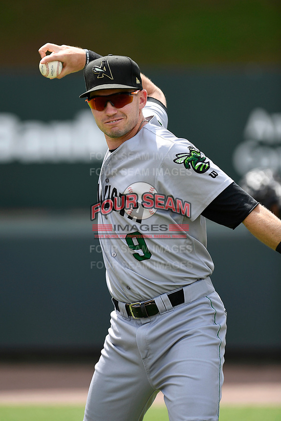 First baseman Ryan Kirby (9) of the Augusta GreenJackets warms up before a game against the Greenville Drive on Thursday, May 17, 2018, at Fluor Field at the West End in Greenville, South Carolina. Augusta won, 2-1. (Tom Priddy/Four Seam Images)