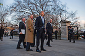 In Washington, DC on February 25, 2010, United States President Barack Obama, along with U.S. Senate Majority Whip Richard Durbin (Democrat of Illinois), U.S. Senate Majority Leader Harry Reid (Democrat of Nevada), and U.S. Vice President Joseph Biden, returns to the White House after hosting a bipartisan meeting with members of Congress to discuss health reform legislation in the nearby Blair House..Credit: Jim Lo Scalzo / Pool via CNP