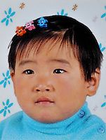 Han Bing (2), born in Aug 2002. Missing in the West of the First Ring Road in Heze, Shandong on 24 Apr 2004.  Girls in China are increasingly targeted and stolen as there is a shortage of wives as the gender imbalance widens with 120 boys for every 100 girls..PHOTO BY SINOPIX