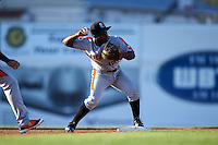 Aberdeen Ironbirds second baseman Kirvin Moesquit (10) throws to first during a game against the Batavia Muckdogs on July 14, 2016 at Dwyer Stadium in Batavia, New York.  Aberdeen defeated Batavia 8-2. (Mike Janes/Four Seam Images)