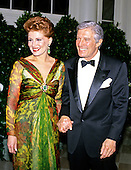 United States Secretary of Commerce Robert A. Mosbacher, Sr. and his wife, Georgette, arrive at the White House in Washington, DC for the State Dinner honoring President Carlos Menem of Argentina on Thursday, November 14, 1991.<br /> Credit: Ron Sachs / CNP