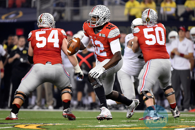 12 JAN 2015:  Cardale Jones (12) of the Ohio State University scrambles against the University of Oregon during the College Football Playoff National Championship held at AT&T Stadium in Arlington, TX.  Ohio State defeated Oregon 42-20 for the national title.  Jamie Schwaberow/NCAA Photos