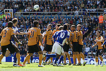 Action from the first half of a Barclay's Premier League match at St. Andrew's between Birmingham City (blue) and Wolverhampton Wanderers. Both clubs were battling against relegation from  England's top division. The match ended in a 1-1 draw, watched by a crowd of 26,027.