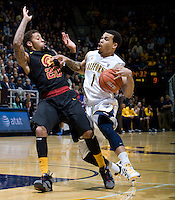 Justin Cobbs of California controls the ball away from Byron Wesley of USC during the game at Haas Pavilion in Berkeley, California on February 17th, 2013.  California defeated USC, 76-68.