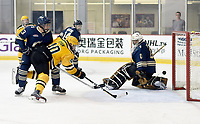 George Mason's Shawn Ryan (40) scores a goal past GW goalie Alec Astorga (0) while falling down. George Mason defeated George Washington 5-2 on 9-22-18.<br />