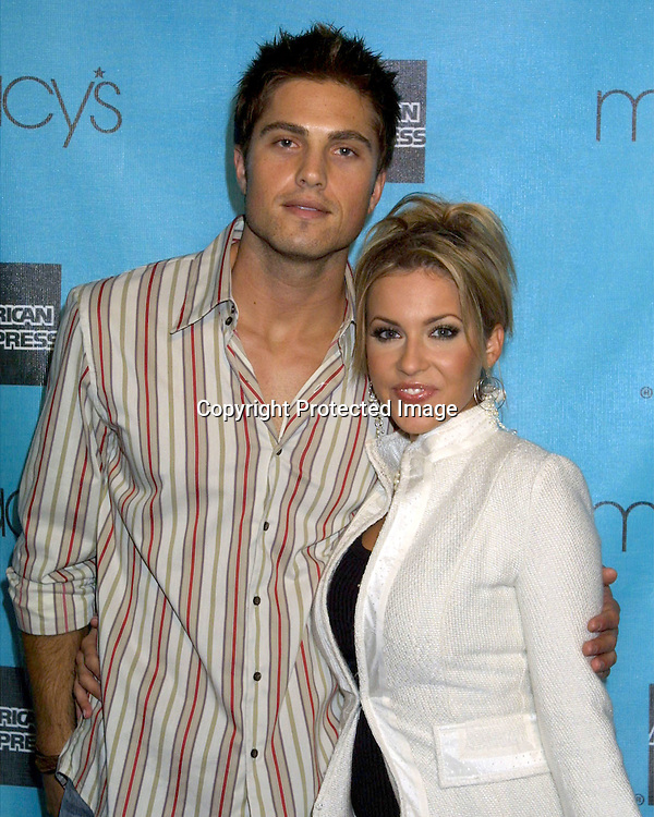 2003 KATHY HUTCHINS / HUTCHINS PHOTO.MACY'S PASSPORT GALA EVENING.BARKER HANGER.SANTA MONICA, CA.OCTOBER 2, 2003.ERIC WINTERS AND FARAH FATH