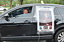 PEMBROKE PINES, FL - MAY 15: A parent displays a graduation photo on a vehicle during the ceremony at Pembroke Pines Charter High School on May 15, 2020 in Pembroke Pines, Florida. Because of social distancing mandates instituted by the state to curtail the spread of COVID-19, the 2020 graduates received their diplomas in a near-empty auditorium with no friends, family or relatives allowed to attend. A video of each student walking the stage to receive their diploma will be streamed on the school's scheduled graduation date of May 29.  ( Photo by Johnny Louis / jlnphotography.com )