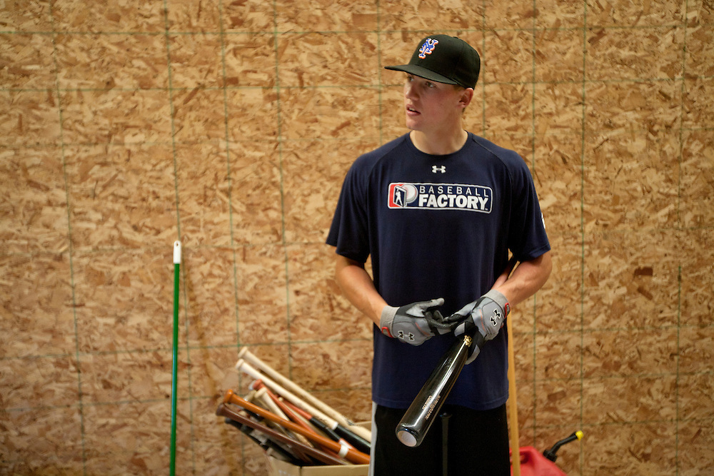 Brandon Nimmo gives a tour of a batting cage that sits in the family barn on Tuesday, June 21, 2011, in Cheyenne, Wyo. (Photo by James Brosher)