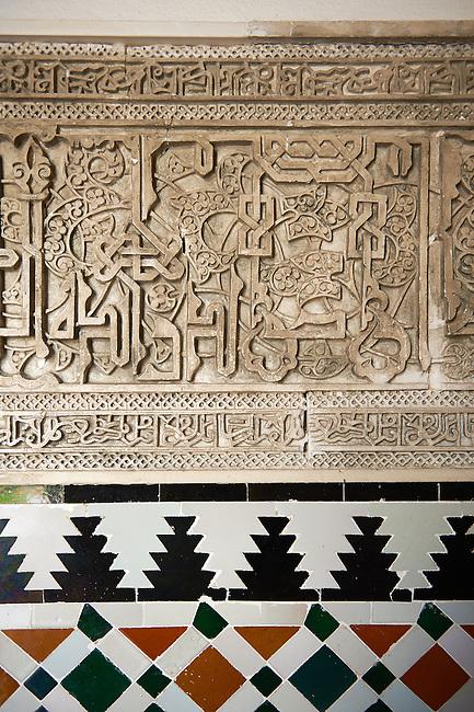 Arabesque Mudjar plaster work and Zillige tiles inside the Vestibule of Don Pedro's Palace, completed in 1366. Alcazar of Seville, Seville, Spain