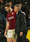 Charlie Goode of Northampton is consoled by Keith Curle manager of Northampton during the FA Cup match at the Pride Park Stadium, Derby. Picture date: 4th February 2020. Picture credit should read: Darren Staples/Sportimage