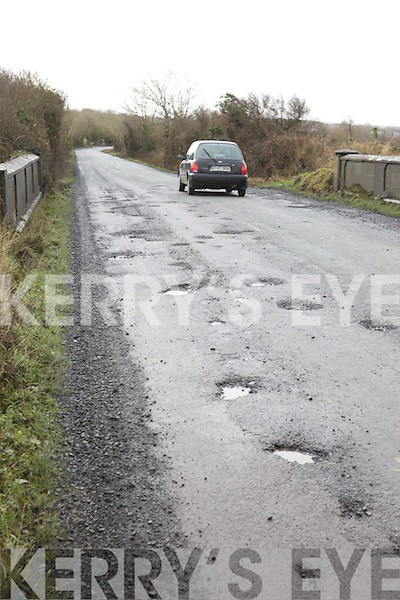 HOLES: Cars being forced to swerve to avoid potholes on the road from Lixnaw to Abbeydorney last week.