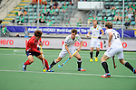 The Hague, Netherlands, June 10: Byungjin Jeon #27 of Korea dribbles the ball during the field hockey group match (Men - Group B) between Germany and Korea on June 10, 2014 during the World Cup 2014 at Kyocera Stadium in The Hague, Netherlands. Final score 6-1 (3-0) (Photo by Dirk Markgraf / www.265-images.com) *** Local caption ***  Byungjin Jeon #27 of Korea, Oliver Korn #18 of Germany, Jan Philipp Rabente #14 of Germany