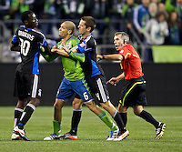 Seattle Sounders FC midfielder Osvaldo Alonso, center scuffles with San Jose Earthquakes midfielder Simon Dawkins and defender Sam Cronin during play at CenturyLink Field in Seattle Saturday October 15, 2011. The Sounders FC won the game 2-1.