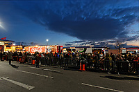 Crowds of people queue to visit the red Coca Cola truck at the carpark of Tesco supermarket in the Llansamlet area of Swansea, Wales, UK. Wednesday 21 November 2018