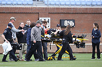 CHAPEL HILL, NC - MARCH 10: Keaton Jones #29 of Bryant University is carted off the field flanked by head coach Mike Pressler and his mother Laci Jones after suffering an injury during a game between Bryant and North Carolina at Dorrance Field on March 10, 2020 in Chapel Hill, North Carolina.