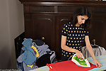 18 year old teenage girl at home, household chores, ironing