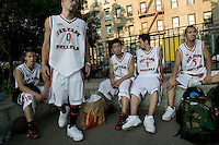 The Far East Ballers, a Japanese street basketball team, play a game against a local team in the Rodney tournament in New York City, USA, June 19 2005.