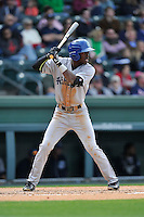 Outfielder Mylz Jones (7) of the Asheville Tourists bats in a game against the Greenville Drive on Sunday, April 10, 2016, at Fluor Field at the West End in Greenville, South Carolina. Greenville won, 7-4. (Tom Priddy/Four Seam Images)