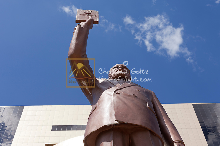 A statue of Sam Nujome holding the Namibian constitution stands in front of the Independence Museum in Windhoek.