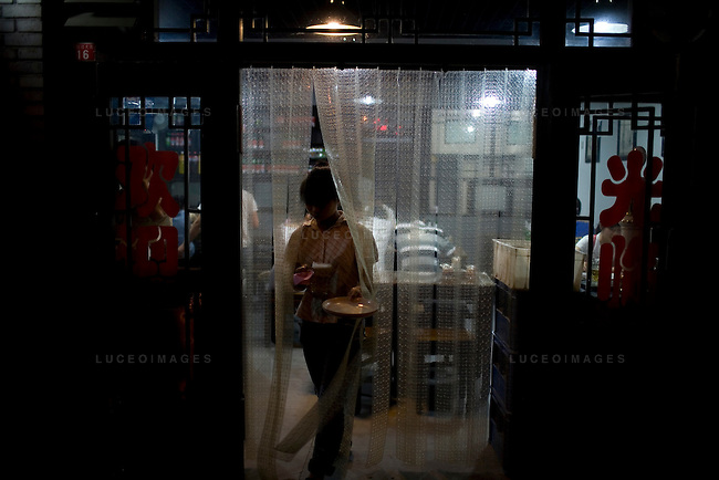 Restaurant worker in Beijing, China on Thursday, August 7, 2008. The city of Beijing is gearing up for the opening ceremonies of the Olympic Games.  Kevin German