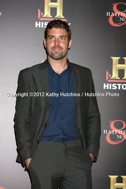 """LOS ANGELES - SEP 22:  Jonathan Fredrick arrives at the """"HATFIELDS & McCOYS"""" Pre-Emmy Party. at SOHO Club on September 22, 2012 in West Hollywood, CA"""