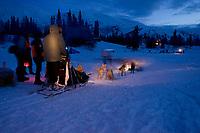 Rick Swenson Checks in @ Finger Lake Chkpt Iditarod 2005 Winter AK Pre-dawn