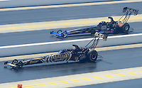 Apr. 14, 2012; Concord, NC, USA: NHRA top fuel dragster driver Khalid Albalooshi (near lane) races alongside Pat Dakin during qualifying for the Four Wide Nationals at zMax Dragway. Mandatory Credit: Mark J. Rebilas-