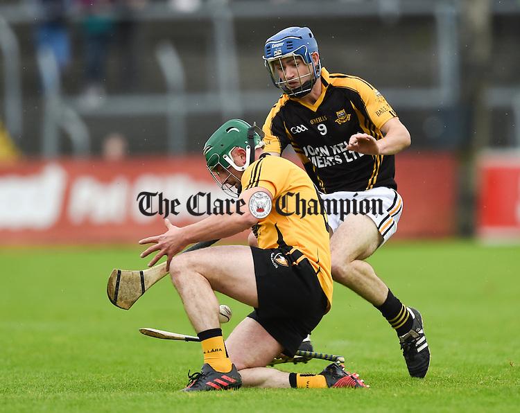 Neil Ryan of Clonlara in action against Stan Lineen of Ballyea during the senior hurling county final at Cusack park. Photograph by John Kelly.