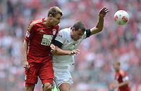 FUSSBALL   1. BUNDESLIGA  SAISON 2012/2013   3. Spieltag FC Bayern Muenchen - FSV Mainz 05     15.09.2012 Holger Badstuber (li,FC Bayern Muenchen) gegen Adam Szalai (1. FSV Mainz 05)